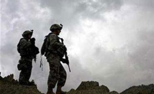 Military deaths pass 2,000 as Afghan war review looms