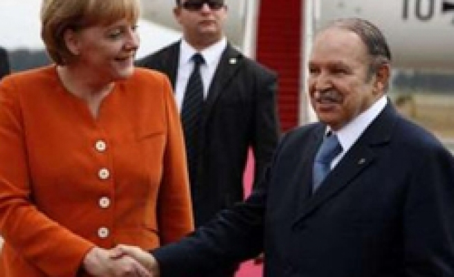 Merkel visits gas-rich Algeria, firm gets mosque contract