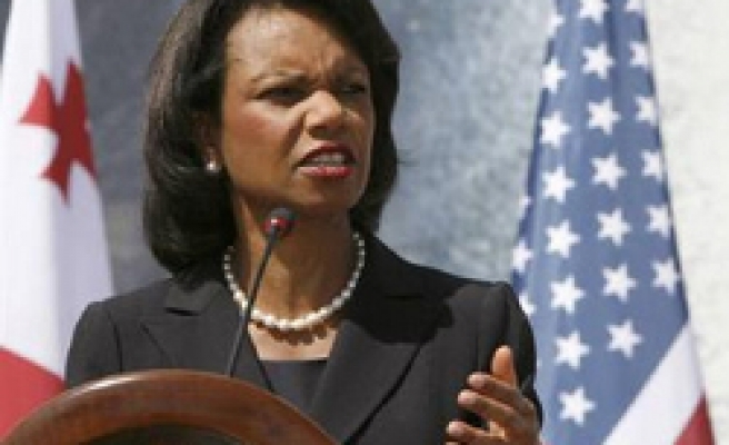 Rice threatens Iran with new sanctions
