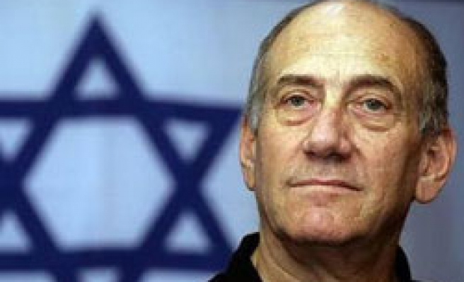 Olmert's party alters charter to hold primary