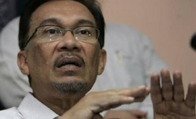Anwar says medical report clears him of sodomy accusation