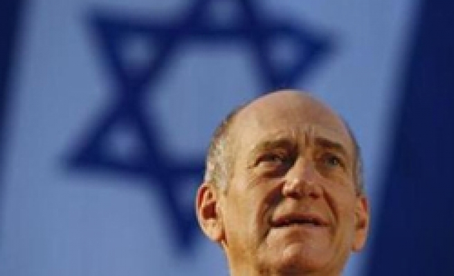 Olmert says to resign in September