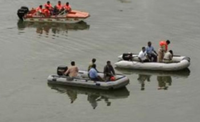 Truck plunges into river in India, 32 killed