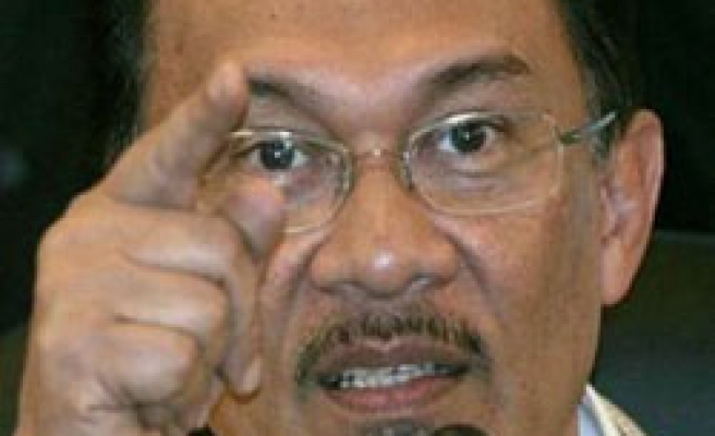 Malaysia opposition figure tells Anwar to quit