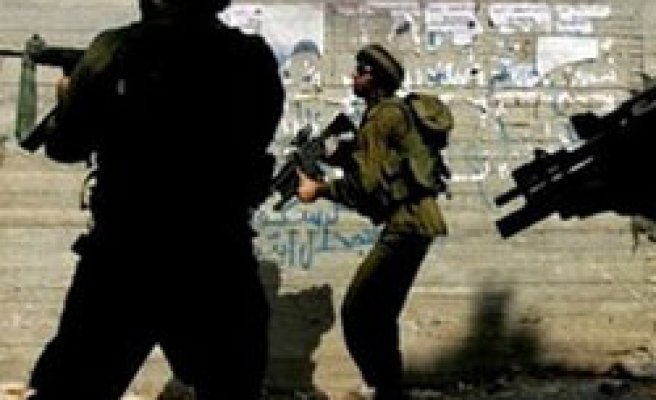 Israeli troops besiege West Bank home after soldier death