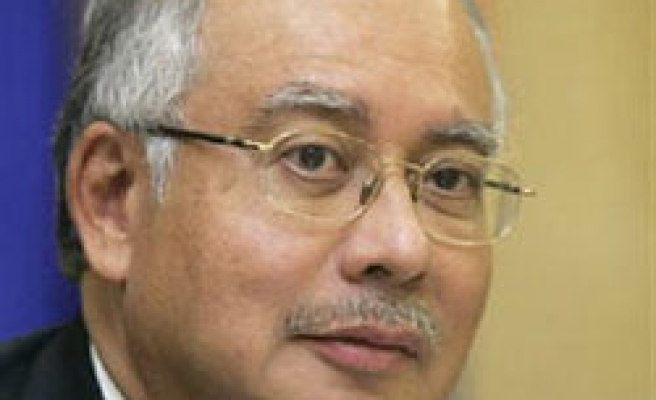 Malaysia's Razak to take PM office on March 31, says report