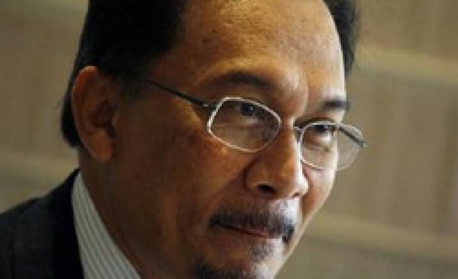 Malaysia opposition party backs Anwar as leader