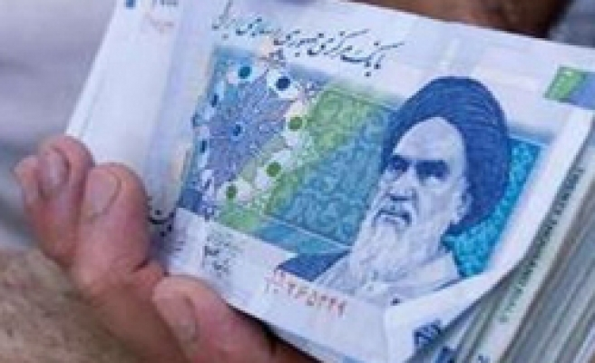 Iran to ban banknote with political slogans: website
