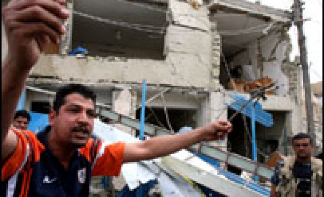 Bombs hit Baghdad police station
