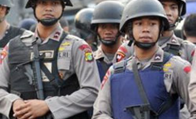 Indonesia reshuffle police officers over election security