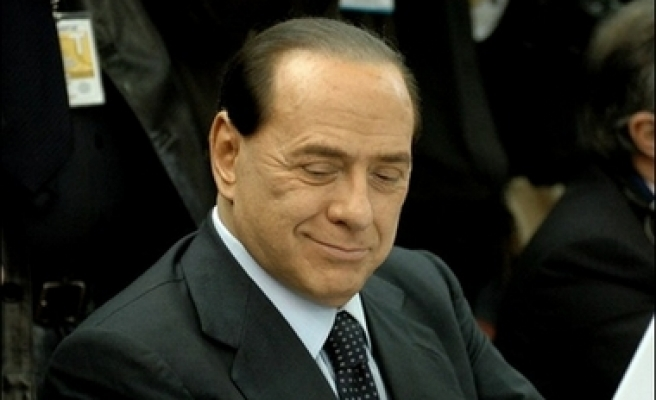 Italy's ex-PM Berlusconi cleared in judge-bribing case