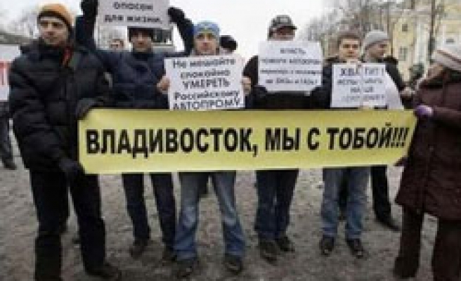 Russia minister says crisis triggering unrest