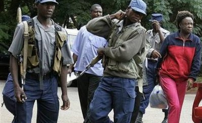 Zimbabwean police lead up activists to undisclosed area