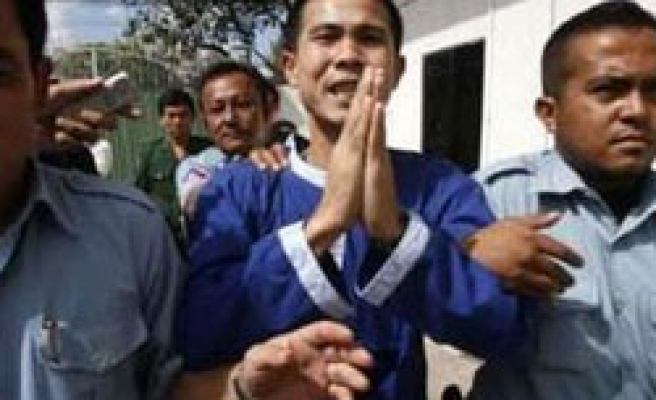 Cambodia orders review of slain union boss case
