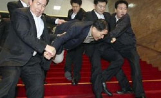 Scuffle in South Korean parliament leaves MPs hurt