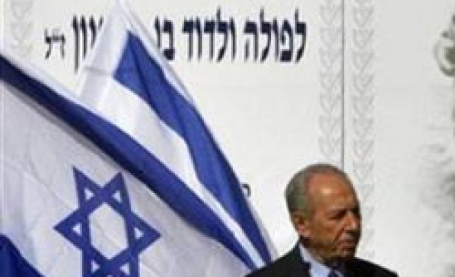 Israel's Peres rejects Gaza cease-fire, denies re-occupation