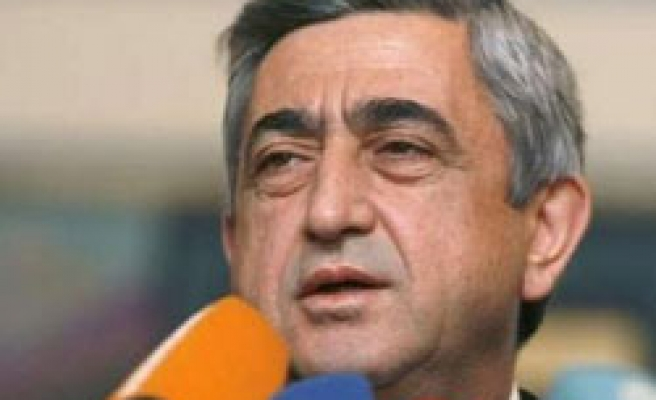 Armenian president pardons 16 over opposition protests