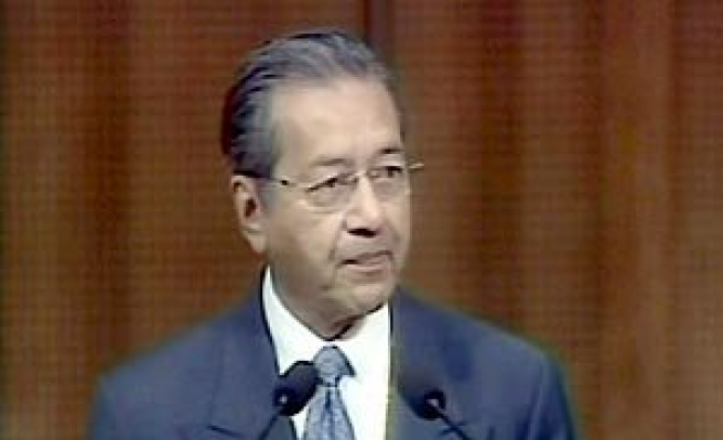 Mahathir says will cut back on activities
