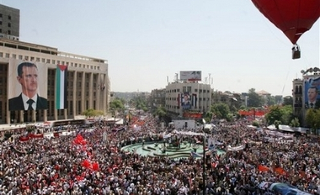 Syrians march to support president