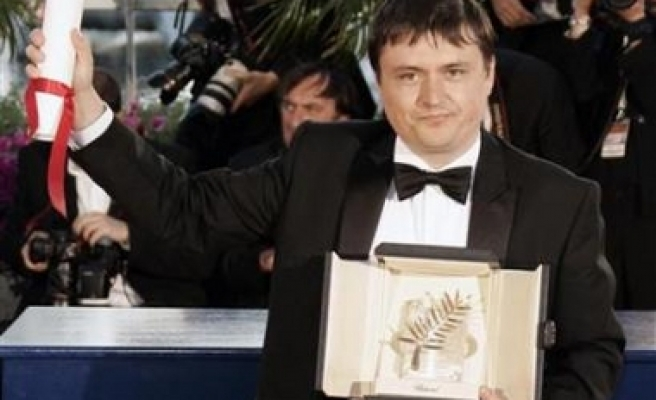 Romanian wins best film in Cannes