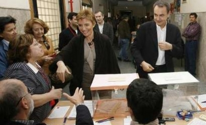Rival parties split Spanish elections
