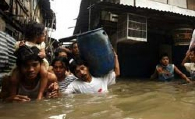 At least 12 killed by floods, waves in Indonesia