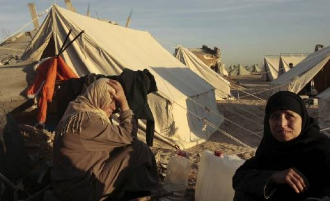 Homeless  Palestinians seek safety in destroyed Gaza's tents