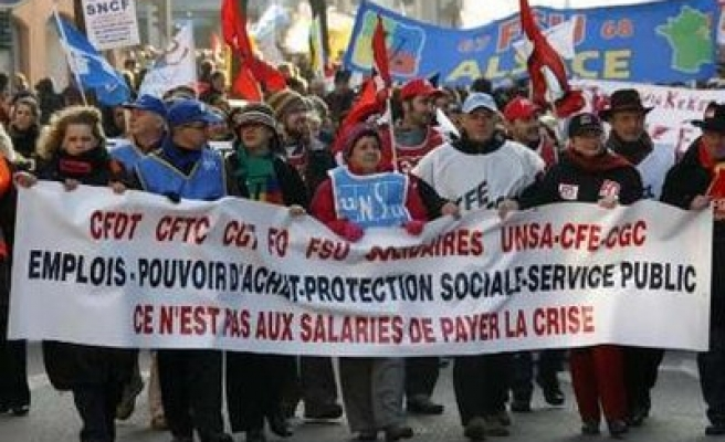 French unions say no concrete action by Sarkozy, call strike