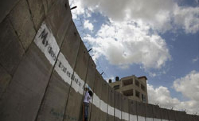 Israel to proceed West Bank wall by rerouting despite ICC ruling