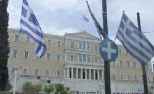 European shares close higher on hopes for Greece