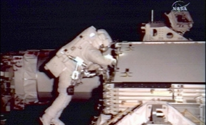 Atlantis astronauts step out on space walk