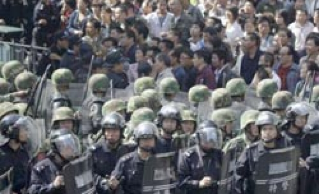 Tensions high in Uighur region, Chinese protests in second day