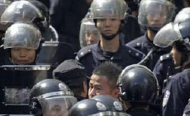 China sacks police chief over Chinese protests in Uighur region
