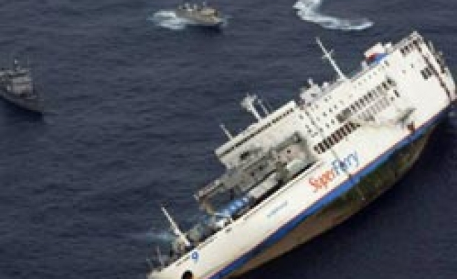Two still missing as Philippines fears oil spill from sunken ferry
