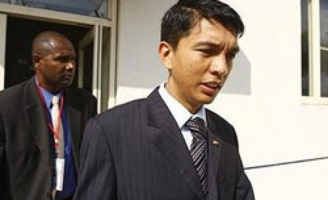 Madagascar leader rejects deals, names colonel as PM