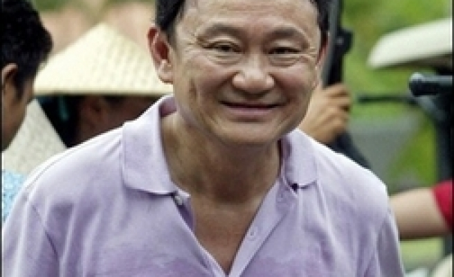 Thaksin ordered to appear before Thai police