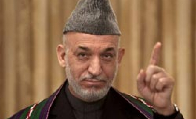 Afghanistan's Karzai to 'retain technocrats in key ministries'