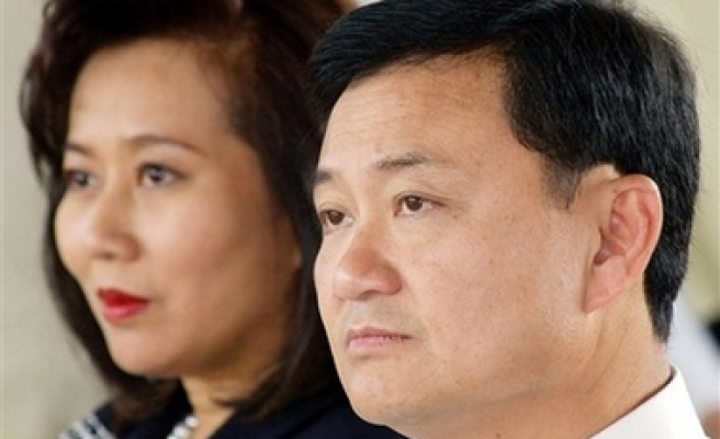 Thai Thaksin charged with criminal corruption