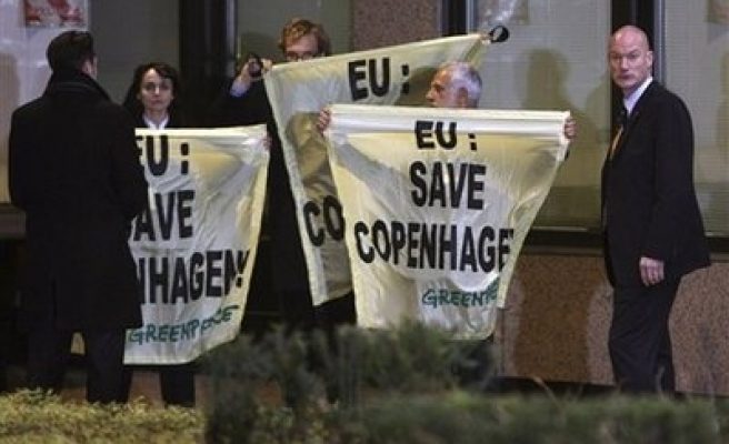 Greenpeace activists protest climate change at EU summit
