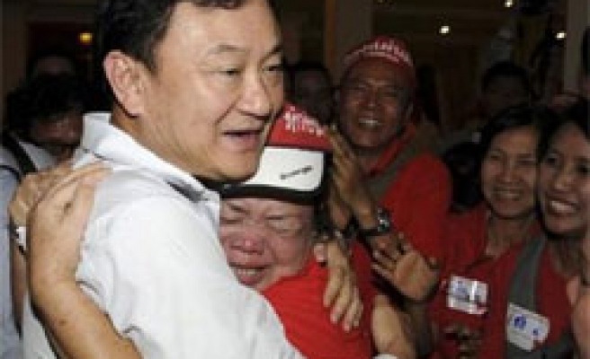 Thaksin back in Cambodia as Thai spy to be freed