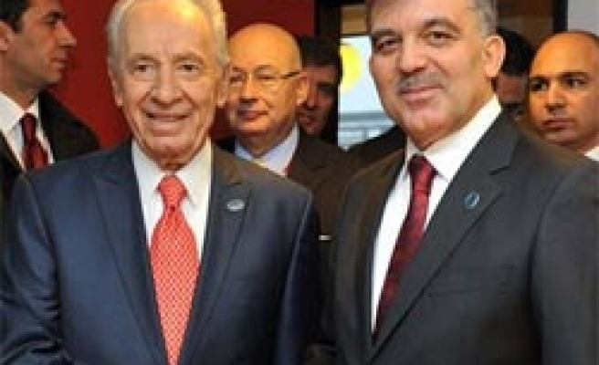 Gul, Peres meet for first time after Gaza attack