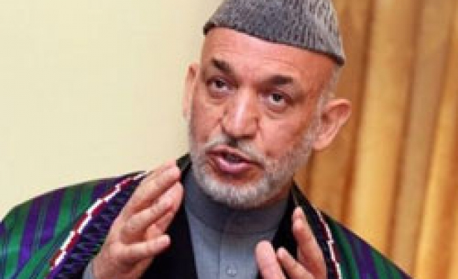 Karzai asks Afghan parliament to suspend break