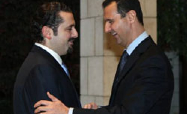 Hariri calls for 'new ties' in landmark Syria visit
