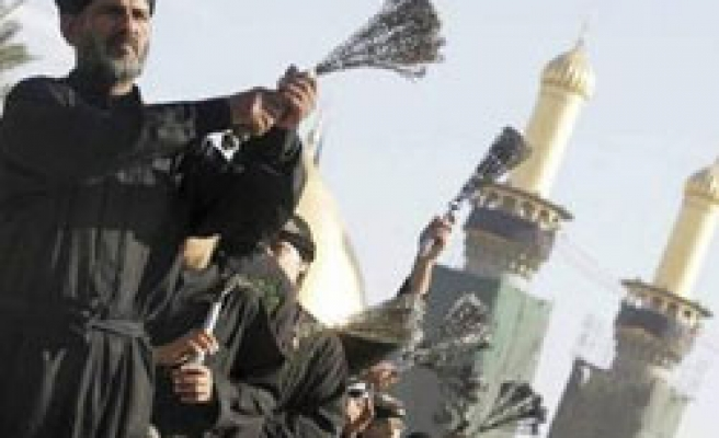 Iraq deploys tens of thousands of troops to protect for Ashura mourners