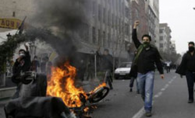 Iran state TV says 8 people killed in protests