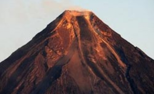 Philippines lowers alert level at restive Mayon volcano