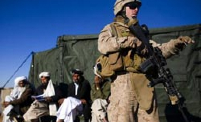 US tells Afghans, 'not here forever' as soldiers set to double