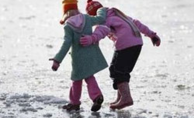 Britain issues flood warnings as snow melting