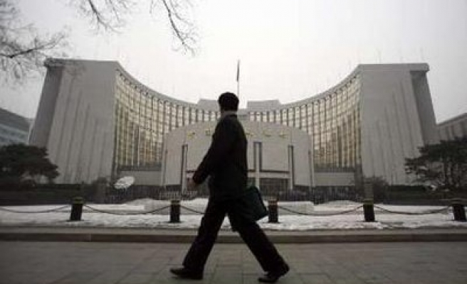 China frees up lending rates