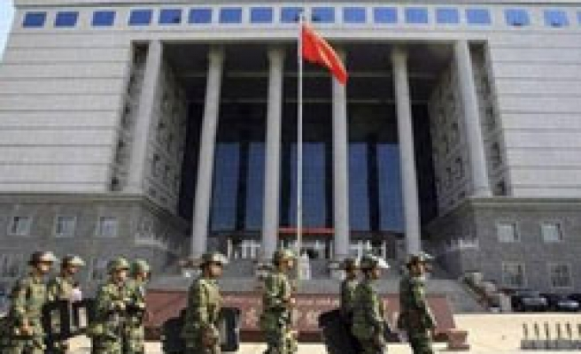 China sentences four more Uighurs to death